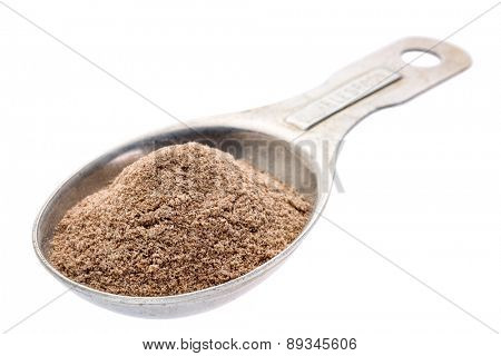 gluten free teff flour on an old aluminum measuring spoon isolated with a clipping path
