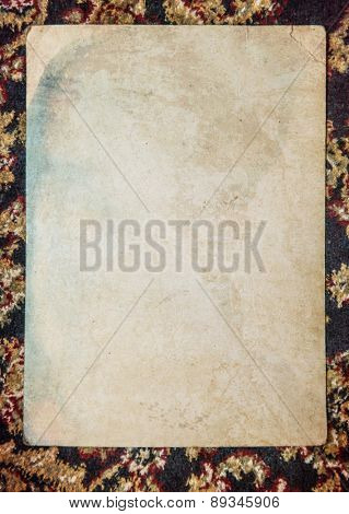 Vintage background with old paper, letters and photos on cloth