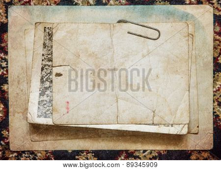 Vintage background with old paper and letters on cloth