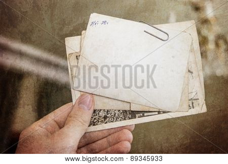 Vintage background with old paper and letters keep in hand