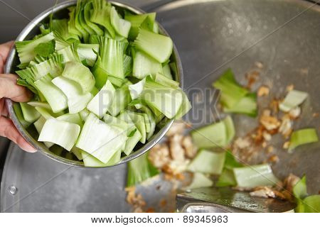 Stir frying Chinese cabbage on the wok