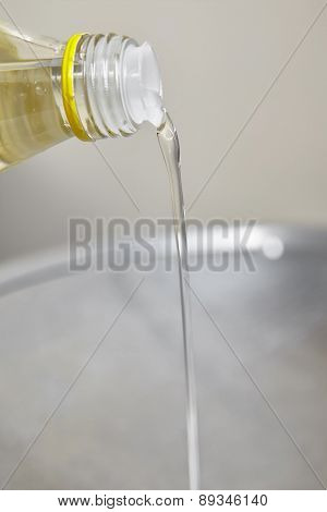 Pouring cooking oil to the wok