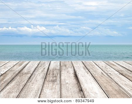 Wooden Pier With Blue Sea And Sky With Cloud