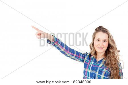 Casual blonde girl indicating at side with the finger isolated on a white background
