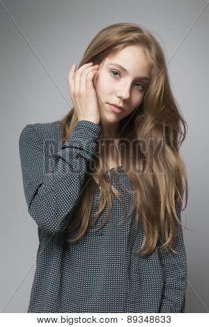 An image of a beautiful teenage girl