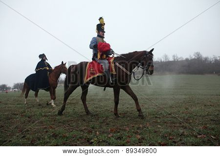 TVAROZNA, CZECH REPUBLIC â?? DECEMBER 3, 2011: Re-enactors uniformed as Austrian cavalry attend the re-enactment of the Battle of Austerlitz (1805) near Tvarozna, Czech Republic.