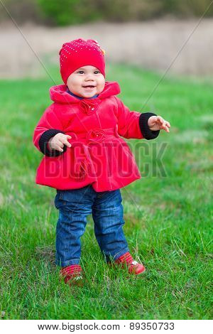 Little girl in red coat
