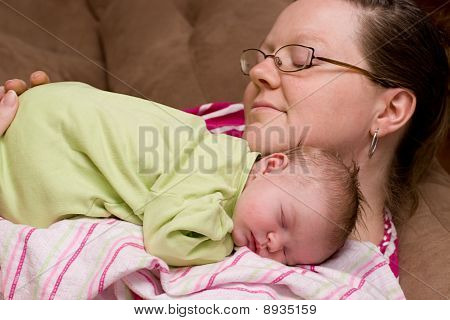 Mother Comforts Sleeping Baby Girl