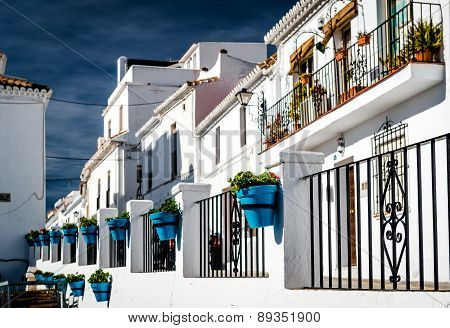 Typical Spanish White Village Houses With Flower Pots.