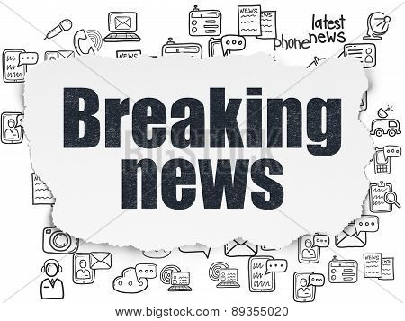 News concept: Breaking News on Torn Paper background