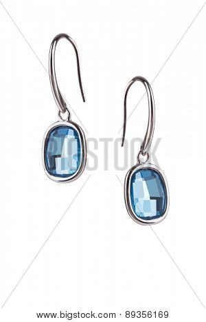 Pair of saphire earrings isolated on white background