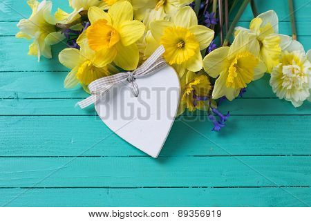 Fresh Yellow And Blue Flowers And Decorative Heart On Wooden Background