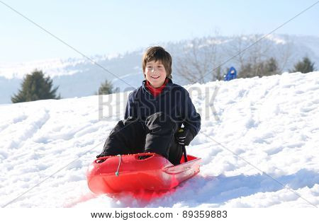 Child With Brown Hair In The Winter Plays With Bob In The Mountains