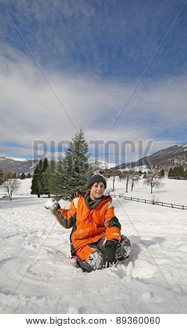 Little Boy Play With Snow In The Mountains In Winter