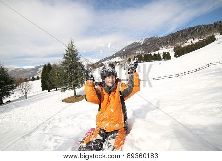Cute Little Boy Play With Snow In The Mountains In Winter