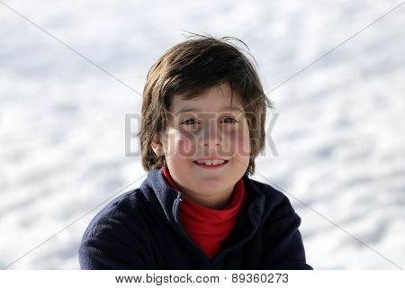 Portrait Of A Cute Young Boy In The Mountains