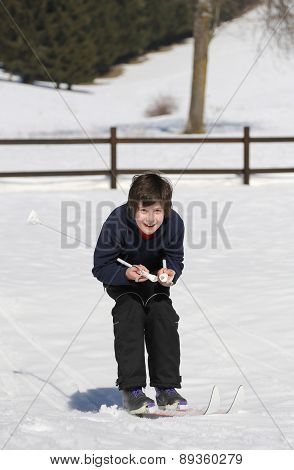Kid Try Cross-country Skiing On The White Snow In The Mountains In Winter