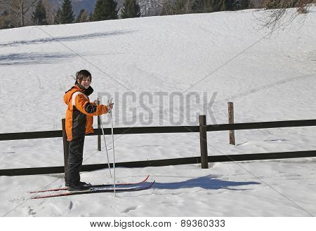 Pretty Young Boy Goes On Cross-country Skiing On The White Snow