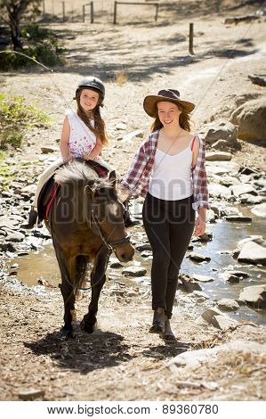 Female Jockey Kid Riding Pony Happy With Mother Role As Little Horse Cowgirl Instructor