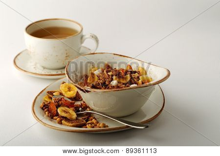 Authentic Muesli And A Cup Of Tea Sprinkled With Cinnamon On A White Tablecloth. Morning Atmospheric