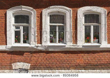 Three Grunge Windows With Red Brick Wall