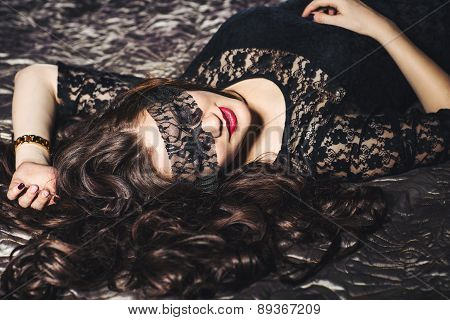 beautiful girl with long hair in blindfold