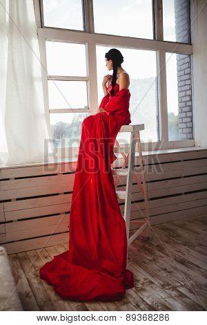 beautiful girl in a long red dress