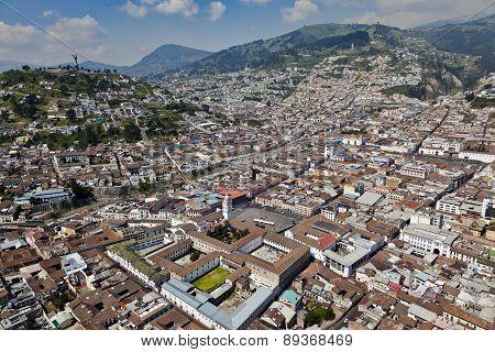 Quito, Ecuador - April 2014: Aerial view of colonial town of Quito; Square and convent of Santo Domingo, Panecillo, Cima de la Libertad