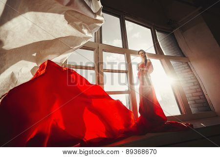 beautiful girl in a long red dress