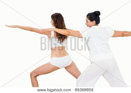 Relaxed women doing yoga on white background