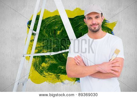 handyman with paintbrush and ladder against white and grey background