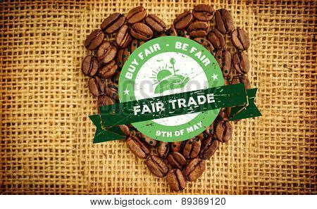 Fair Trade graphic against heart made from roasted coffee beans