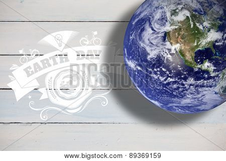 earth against painted blue wooden planks