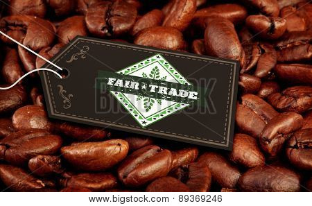 Fair Trade graphic against coffee seeds laid out together