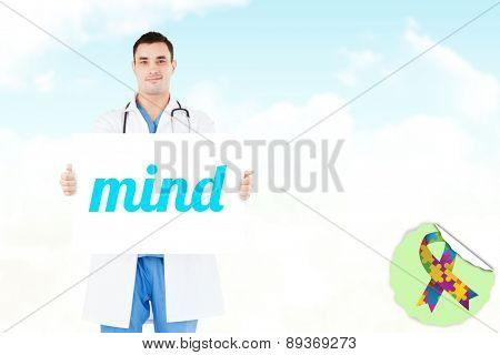 The word mind and portrait of a doctor holding a blank panel against blue sky