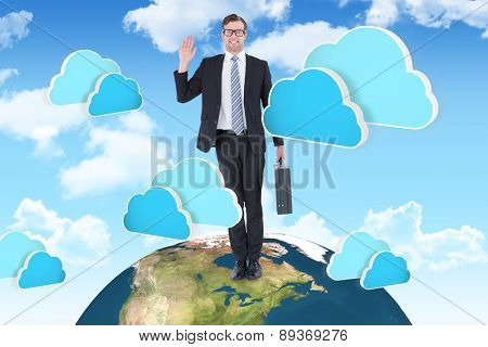 Geeky hipster businessman waving at camera against two blue clouds for cloud computing