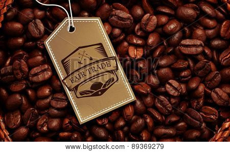 Fair Trade graphic against close up of a basket full of dark coffee beans