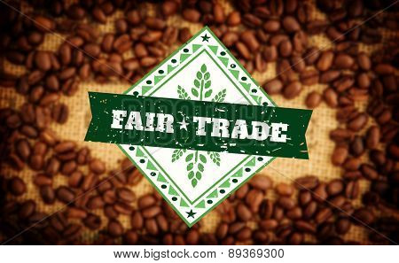 Fair Trade graphic against coffee beans surrounding coffee stamp on sack