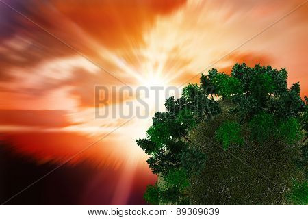Sphere covered with forest against sunrise over grass