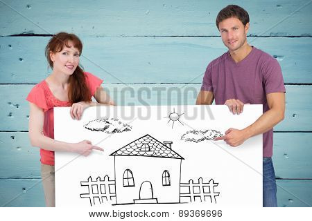 Couple looking at the camera against painted blue wooden planks