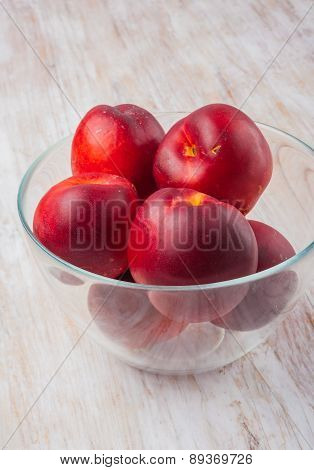Nectarines In A Glass Bowl
