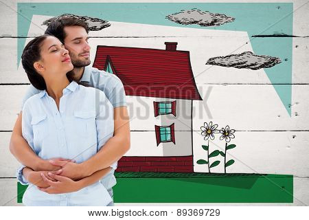 Cute couple embracing with eyes closed against white wood