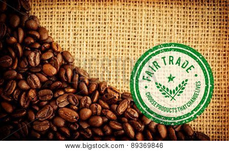 Fair Trade graphic against coffee beans and burlap sack