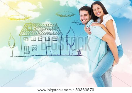 Happy casual man giving pretty girlfriend piggy back against blue sky