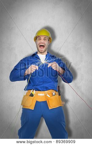 Repairman screaming while holding wires against white background