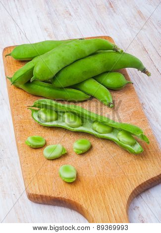 Fresh Broad Bean On Kitchen Board