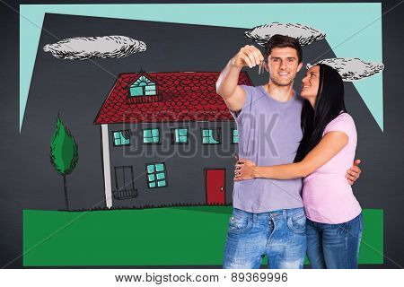 Young couple showing keys to house against black background