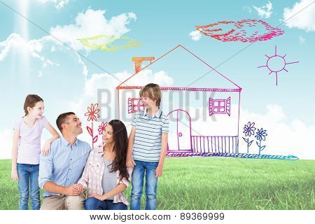 Family smiling while looking at each other against blue sky over green field
