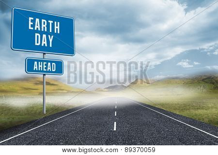 earth day ahead against cloudy landscape background with street