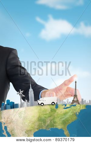 Businessman hand pointing something against blue sky